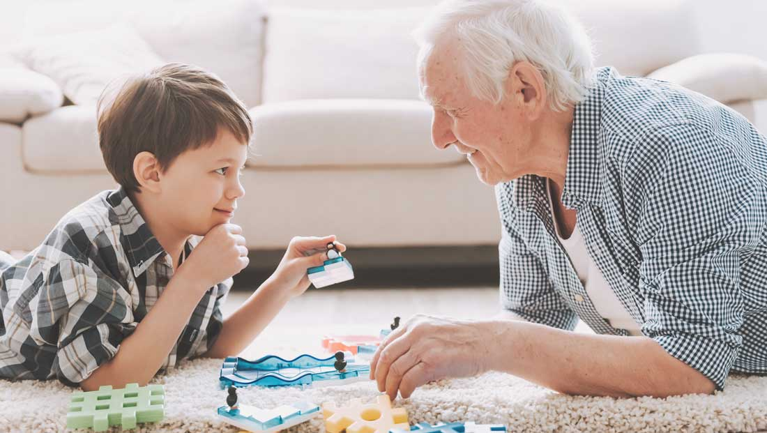 kid plays game with grandparent