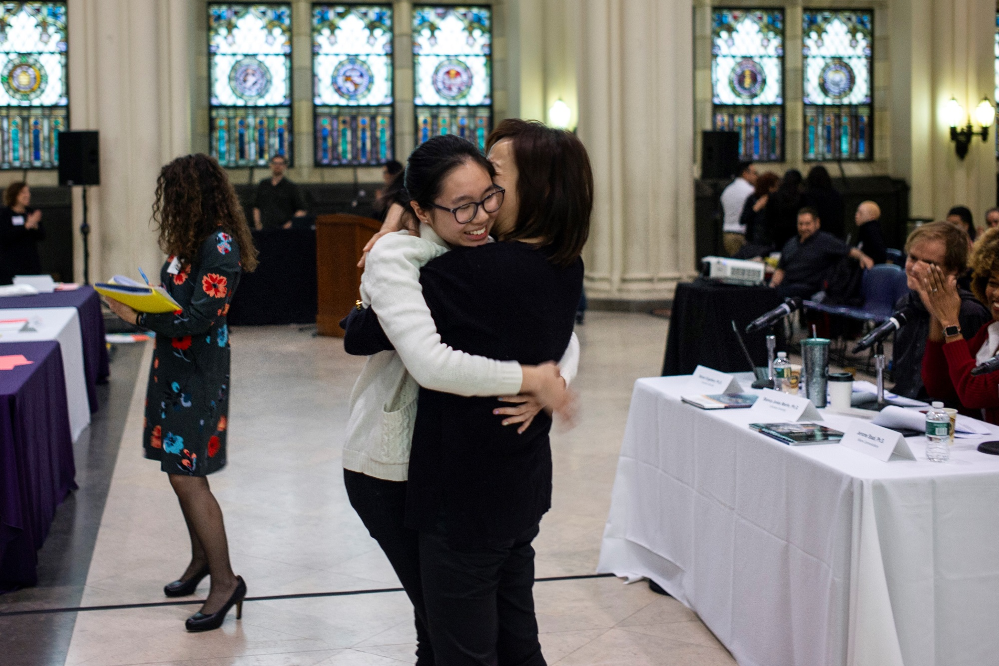 Kelly Chan hugs her mother
