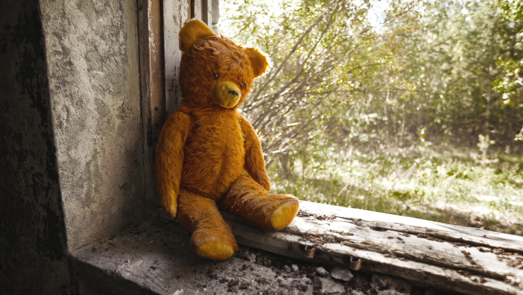 teddy bear in abandoned building