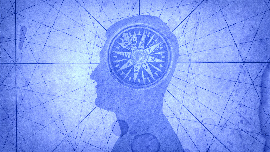 blue silhouette with compass as brain