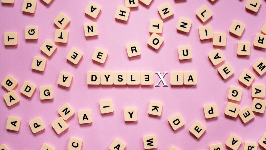 jumbled scrabble letters spelling dyslexia